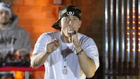- Eminem slammed for using gunshot sound on stage