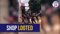 WATCH: Residents loot shop opposite Dobsonville police station