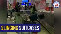 WATCH: OR Tambo baggage handler caught slinging suitcases, suspended