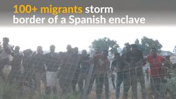 Migrants cheer as they storm border of Spanish enclave