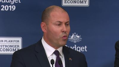 Election footage of Morrison promising immediate tax rebate that looks set to be delayed