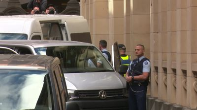 George Pell leaves court in a prison van after losing appeal