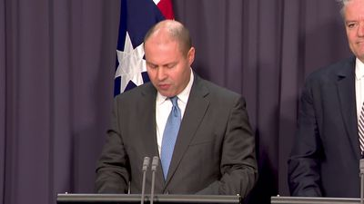 Frydenberg says the budget will be back in the black, reveals lower spend on NDIS