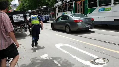 CCTV of James Gargasoulas mounting the footpath on Swanston St sending dozens scrambling for their l