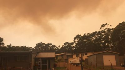 RAW: Smoke fills sky as fire rages near Lake Tabourie property