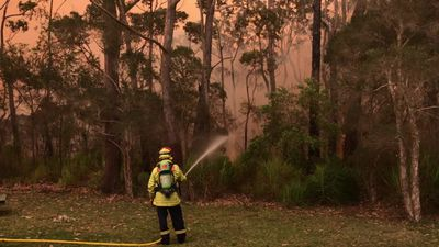 RAW: Firefighter battles flames ta Lake Tabourie