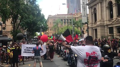 Invasion day protestors march though Brisbane CBD