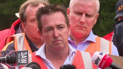 Paul Toole of the NSW Nationals speaks to the media at the site of the Wallan train derailment