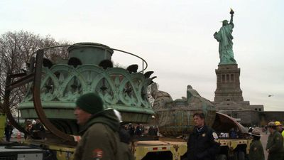 Statue of Liberty's original torch is taken to new museum