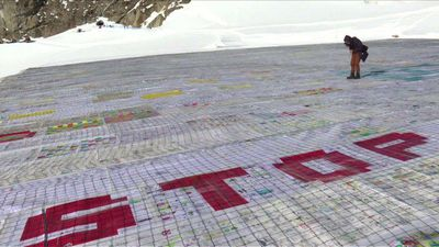 Gigantic postcard on Swiss glacier asking to stop climate change
