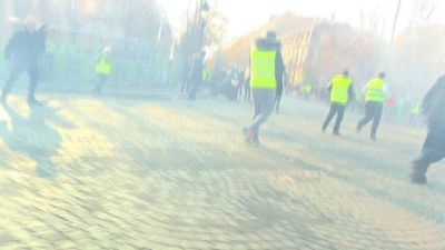"""Tempers begin to fray at """"yellow vest"""" protests in Paris"""