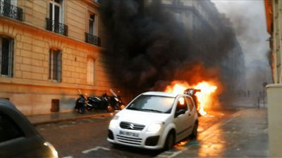 Car and rubbish bins set on fire near the Champs-Elysées