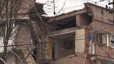 Rescuers dig through rubble of Ukraine flats after gas explosion