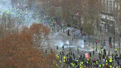 Police fire tear gas on Champs-Elysees' 'yellow vest' protests