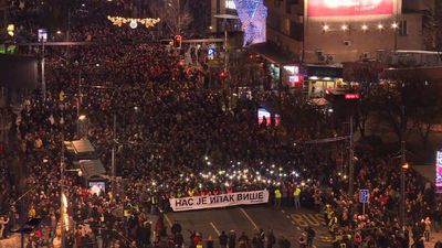 Belgrade protesters march in honour of murdered politician