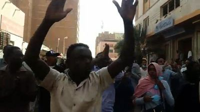 Sudanese protesters march in downtown Khartoum
