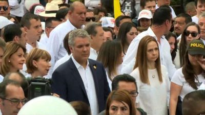 Colombian president joins thousands for march against violence