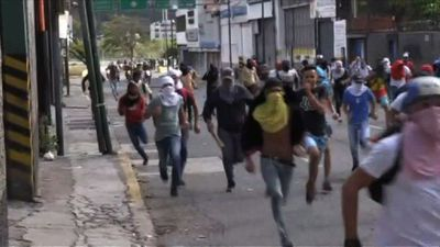 Protesters clash with police in Venezuela on day of mass protest