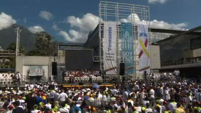Opposition volunteers gather in Caracas for rally about aid