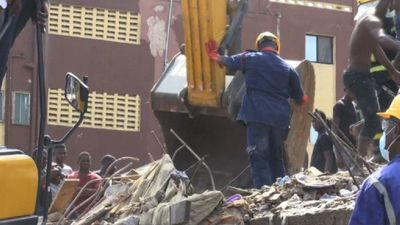 Emergency workers on scene of Lagos building collapse