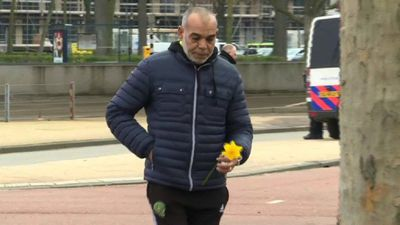 Mourners lay flowers near scene of Utrecht tram gun attack