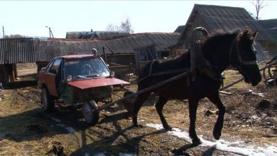 In the Belarusian countryside, a farmer rides a 'horse-mobile'