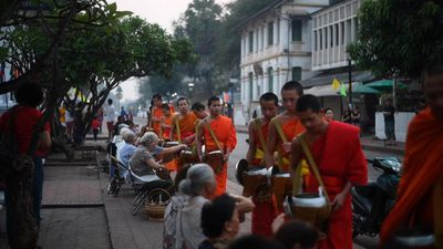 Buddhist monks receive alms in Luang Prabang