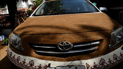 Indian woman covers car in cow dung to avoid heat