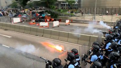 Police charge and fire tear gas at protesters in Hong Kong