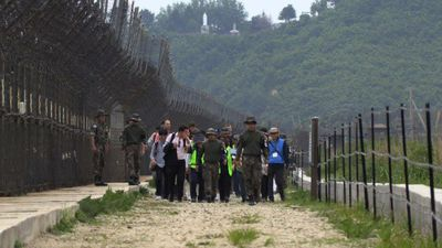 South Koreans join hike along a trail in the DMZ