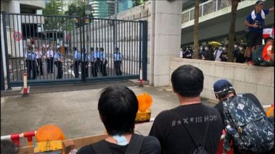 Hong Kong protesters gather near police station
