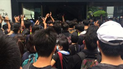 Hong Kong protesters gather at tax office