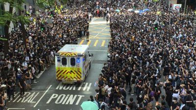 Hong Kong protesters give way to ambulance