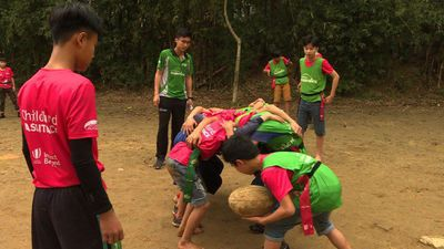 'Turtle shell' scrums: barefoot rugby in Vietnam
