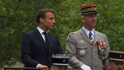 Macron arrives for Bastille Day parade