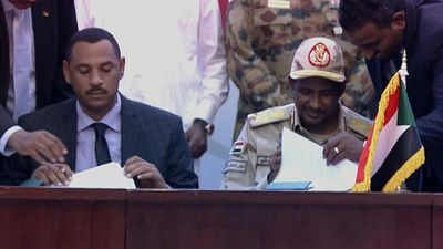 Sudanese sign historic deal for a transition to civilian rule