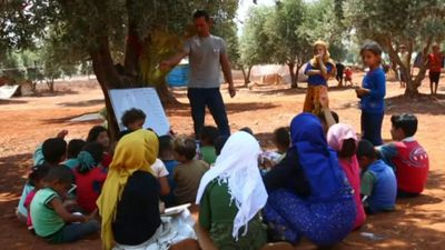 Displaced Syrian teacher gives free classes at an IPD camp in Idlib
