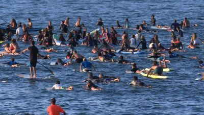 Surfers rally for the planet ahead of G7