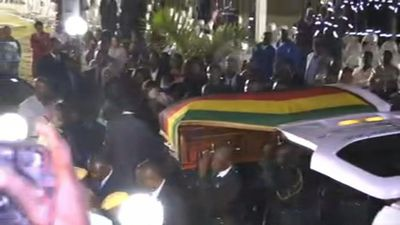 """Coffin of ex-president Mugabe arrives at his former residence """"Blue Roof"""" in Harare"""