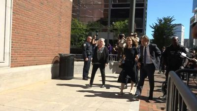 Felicity Huffman arrives at court in Boston