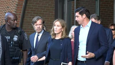 Actress Felicity Huffman leaves court, sentenced to 14 days in jail