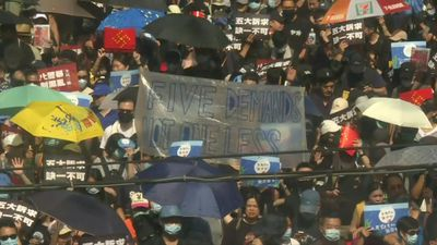 Large rally in Hong Kong as protesters again defy police ban
