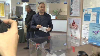 Polish politician Robert Biedron votes in the parliamentary elections