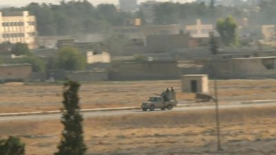 Smoke rises above Syrian town reportedly seized by Turkey and proxies