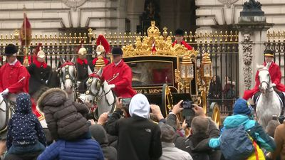 Queen Elizabeth II leaves Buckingham Palace by horse-drawn carriage