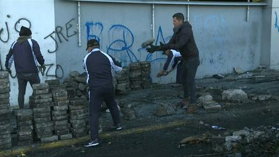 Workers clean Quito's streets after govt and protesters reach deal