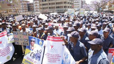 Police officers protest in Pretoria against gender-based violence