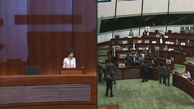 Hong Kong leader abandons policy speech after heckling from lawmakers