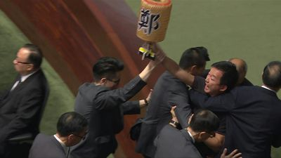 HK lawmakers dragged from chamber as leader heckled for second day