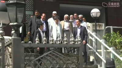 Hong Kong leader visits mosque sprayed by police watercannon